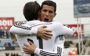 Ronaldo dan Bale merayakan gol ke gawang Getafe, dalam lanjutan La Liga, Minggu (18/1) malam WIB.