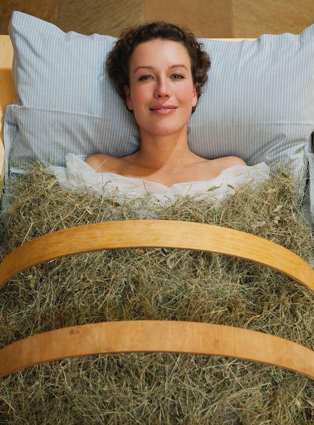 Woman-having-hay-bath-in-hotel-urthaler
