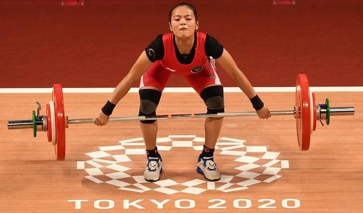 Windy Cantika Aisah meraih medali perunggu cabang angkat besi kelas 49 kg putri, medali pertama Indonesia di Olimpiade Tokyo 2020, Sabtu (24/7/2021).